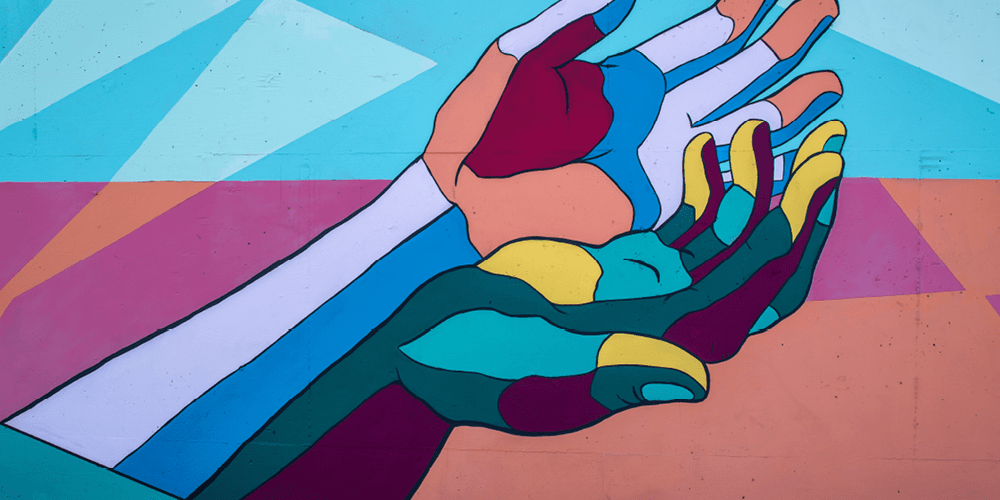 colourful mural with hands outstretched depicting mental health