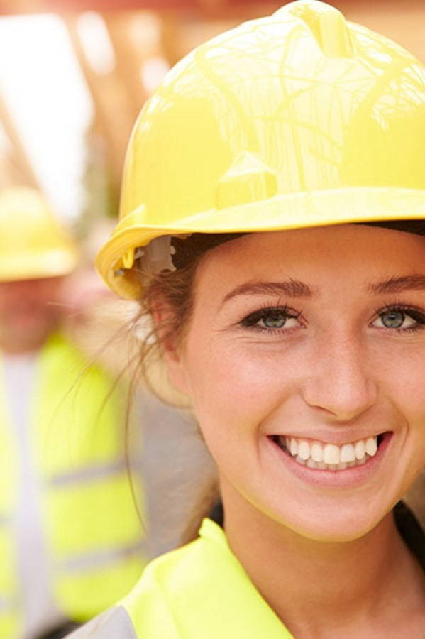 Trojan worker in hard hat smiling at camera