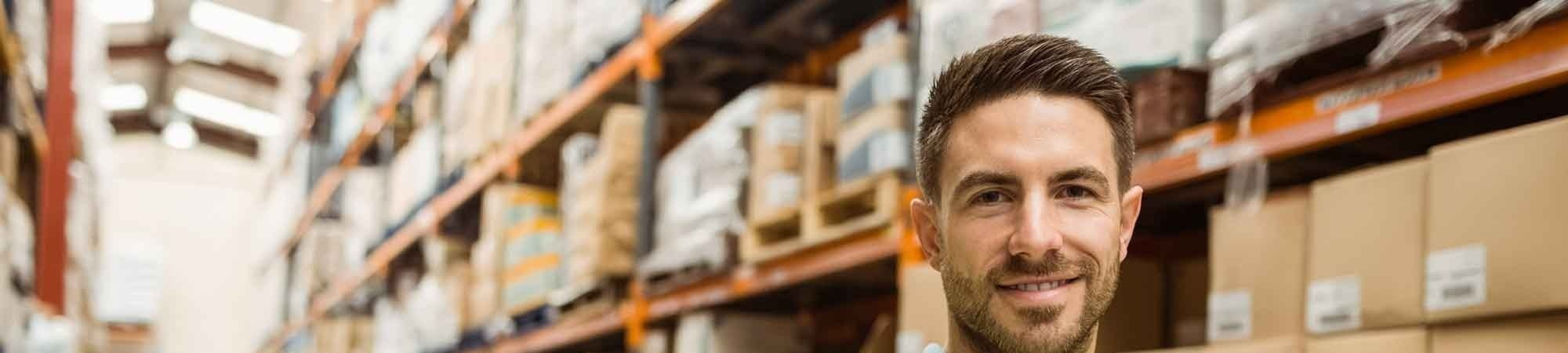 smiling man in warehouse